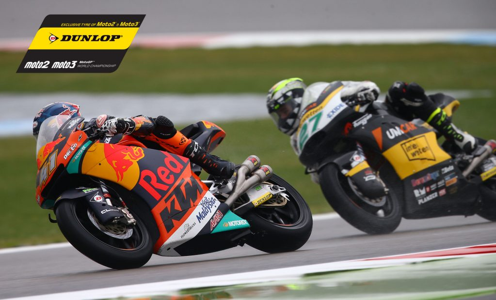 Riders on Dunlop tyres involved in some close action racing as usually seen during Moto2