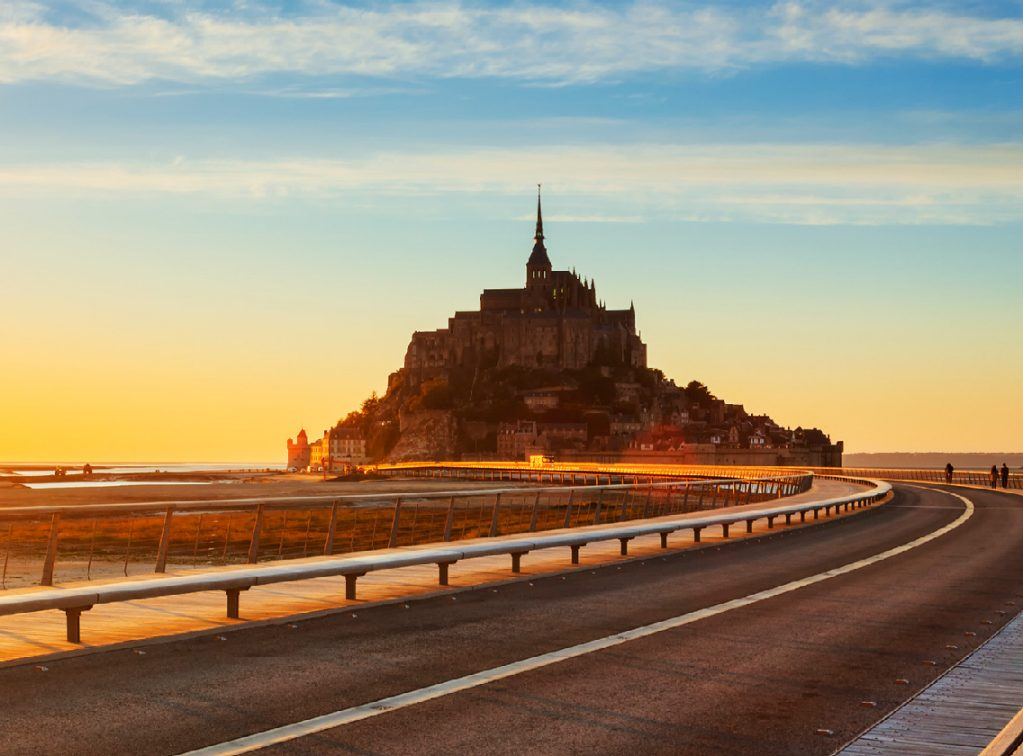 Sun rising on the road to Mont Saint Michel, Normandy