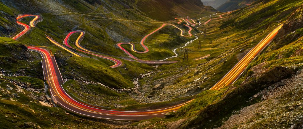 Traffic trails on Transfagarasan pass at sunset in Romania