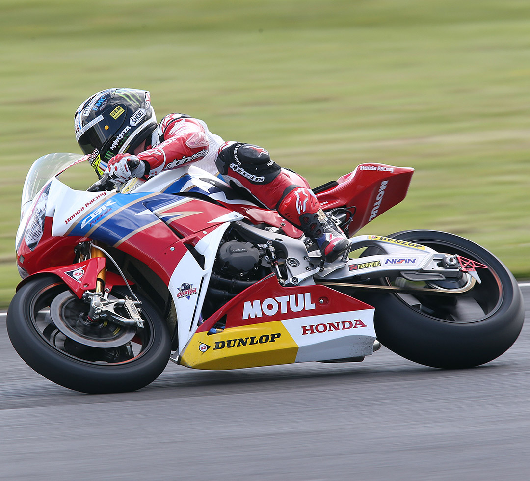Honda racing bike on the track on Dunlop tyres